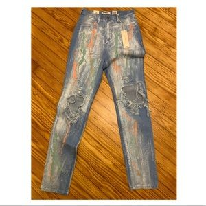 NWT super cute distressed with paint ripped jeans